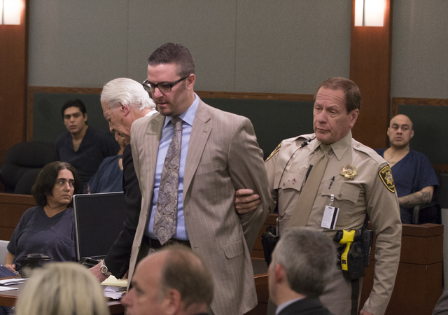Defense lawyer Brian Bloomfield is taken into custody on Monday, March 7, 2016, in Las Vegas at the conclusion of a sentencing hearing at the Regional Justice Center, 200 Lewis Avenue, for his rol ...
