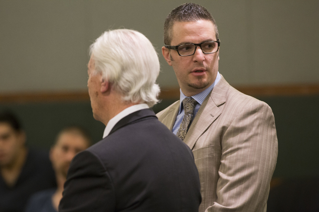 Defense lawyer Brian Bloomfield looks through the crowd for his parents while addressing the court during a sentencing hearing at the Regional Justice Center, 200 Lewis Avenue, for his role in a c ...