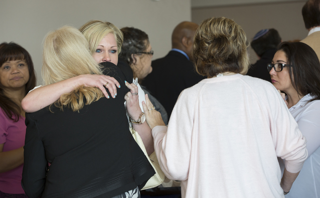 Amber Bloomfield, estranged wife of Brian Bloomfield, hugs her family outside the courtroom at the conclusion of asentencing hearing at the Regional Justice Center for Brian Bloomfield's role in ...