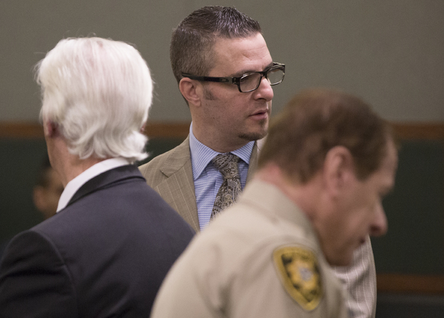 Defense lawyer Brian Bloomfield looks back at family and friends before the start of his sentencing hearing at the Regional Justice Center for his role in a courthouse counseling scheme on Monday, ...