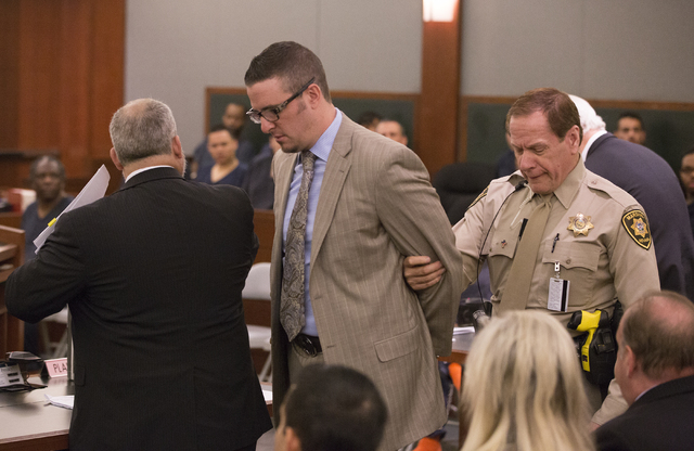 Defense lawyer Brian Bloomfield is taken into custody on Monday, March 7, 2016, at the conclusion of his sentencing at the Regional Justice Center for his role in a courthouse scheme. Benjamin Hag ...