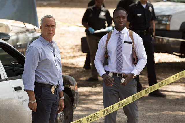 L-R Titus Welliver, Jamie Hector Detective Harry Bosch (Welliver) and his partner Jerry Edgar (Hector) examine a crime scene.  Photo Credit: Amazon Studios