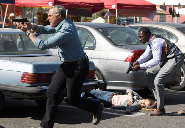 Detective Harry Bosch (Titus Welliver), left, and his partner Jerry Edgar (Jamie Hector) are caught in a shootout.  (Amazon Studios)