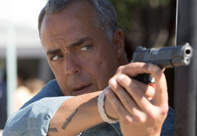 "Harry Bosch (Titus Welliver) hunts for a suspect in the Amazon drama ""Bosch.""  (Amazon Studios)"