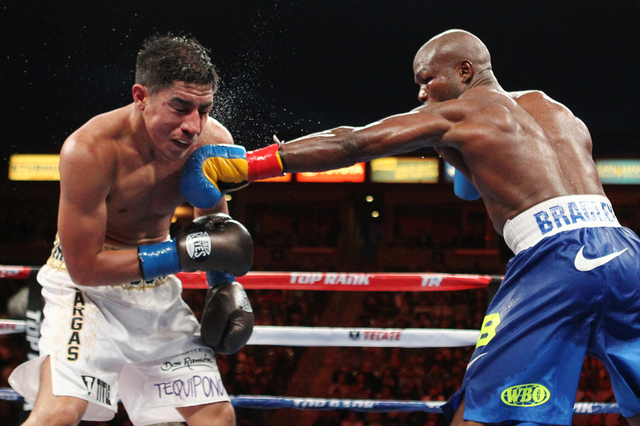 Timothy Bradley Jr., right, connects a left punch against Jessie Vargas in the 11th round of their World Boxing Organization interim welterweight title match at StubHub Center in Carson, Calif., o ...