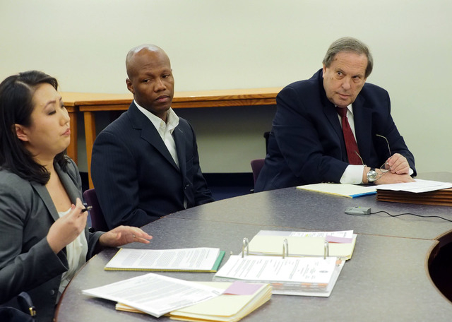 Boxer Zab Judah, center, and his attorney Jay Brown, right, listen as Deputy Attorney General Caroline Bateman presents evidence during a disciplinary hearing by the Nevada Athletic Commission con ...