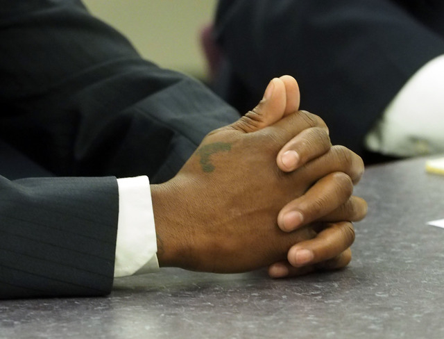 Boxer Zab Judah's hands are seen during a disciplinary hearing by the Nevada Athletic Commission concerning boxer Zab Judah and promoter Roy Englebrecht at the Sawyer State Office Building in Las  ...