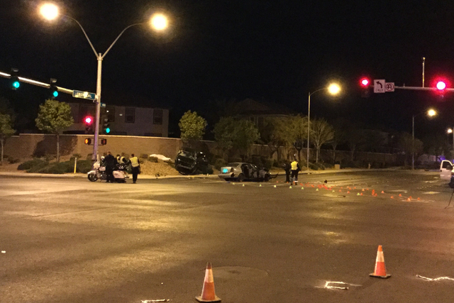 One car sits off the road and another remains in the eastbound lane of Tropical Avenue at North 5th Street in after a crash killed one person and injured six others in North Las Vegas on Wednesday ...