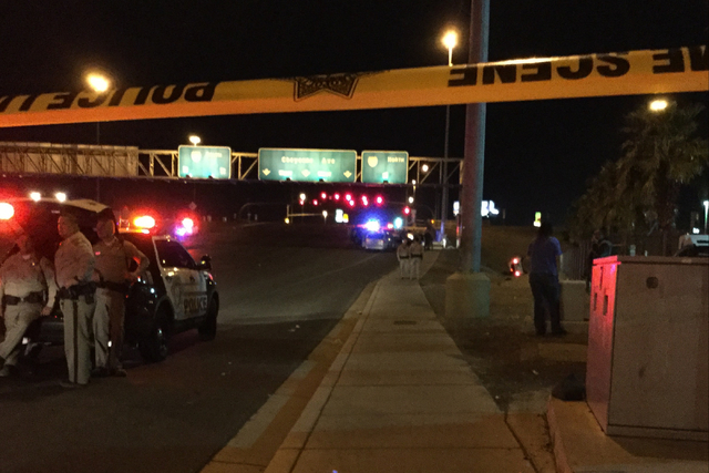Cheyenne Avenue is closed in both directions at the I-15 overpass as police investigate a crash that left one car on its side in Las Vegas on Wednesday, March 9, 2016. The tail lights of the car a ...