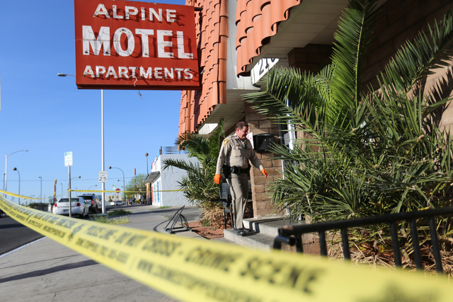 Metro police officers investigate an early morning shooting at the Alpine Motel, 213 N. Ninth St., in downtown Las Vegas on Friday, March 25, 2016. (Brett Le Blanc/Las Vegas Review-Journal Follow  ...