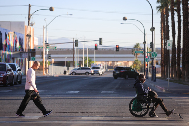 Pedestrians cross Seventh Street at Ogden Avenue on Thursday morning, March 17, 2016. (Brett Le Blanc/Las Vegas Review-Journal Follow @bleblancphoto)
