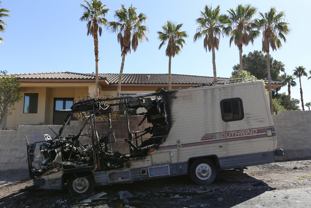 A burned out motor home sits on the side of Westwind Road near the intersection of Lindell Road and Desert Inn Road on Thursday, March 17, 2016. Firefighters responded to a report of a fire at abo ...
