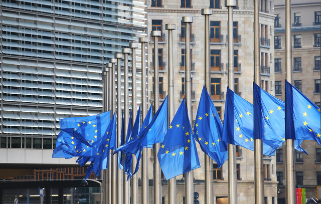 Flags of the European Union fly at half-mast outside the European Council building in Brussels, Belgium, on Tuesday, March 22, 2106, after explosions ripped through the Brussels airport departure  ...