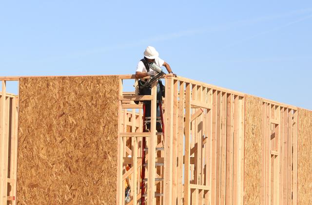 A carpenter works on a new home under construction on Antelope Ridge Drive Tuesday, March 15, 2016, in Las Vegas. Bizuayehu Tesfaye/Las Vegas Review-Journal Follow @bizutesfaye