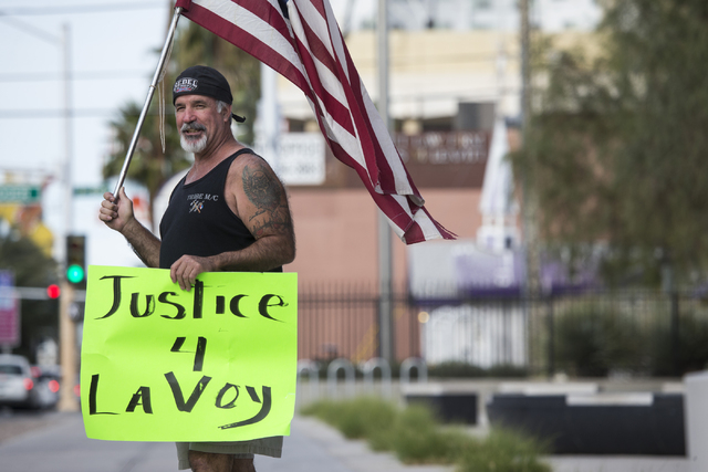 Rick Pollard protests to demand justice for the death of Oregon Occupier LaVoy Finicum and to show support for Bunkerville rancher Cliven Bundy outside of the Lloyd George Federal Courthouse in La ...