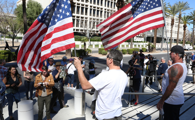 Greg Whaler, left, and Rick Pollard, both of Las Vegas, protest outside the Lloyd George Federal Building on Thursday, March 10, 2016, in Las Vegas. Cliven Bundy appears in court this afternoon. B ...