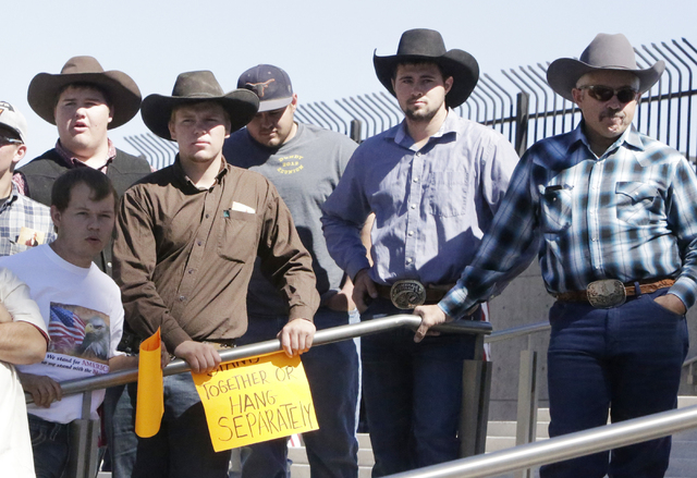 Arden Bundy, son of Cliven Bundy, second left, protests with others outside Lloyd George Federal Building on Thursday, March 10, 2016, in Las Vegas. Cliven Bundy appears in court this afternoon. B ...
