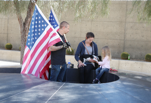 Brian Enright, left, his wife, Leslie, their daughter, Marine, 4, and their dog, Mia, rest after protesting outside Lloyd George Federal Building on Thursday, March 10, 2016, in Las Vegas. Cliven  ...