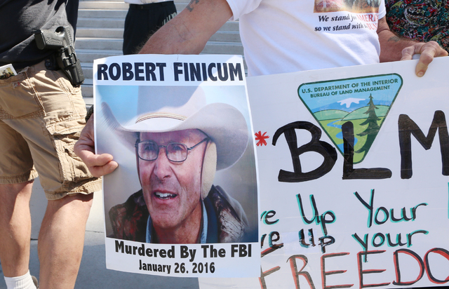People protest outside Lloyd George Federal Building on Thursday, March 10, 2016, in Las Vegas. Cliven Bundy appears in court this afternoon. Bizuayehu Tesfaye/Las Vegas Review-Journal Follow @biz ...