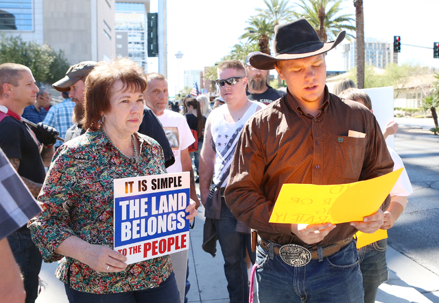Carol Bundy, wife of Cliven Bundy, and her son Arden protest outside Lloyd George Federal Building on Thursday, March 10, 2016, in Las Vegas. Cliven Bundy appears in court this afternoon. Bizuayeh ...