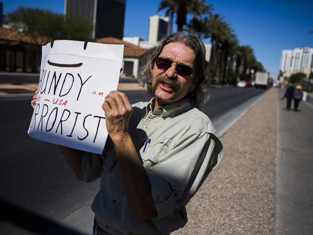 A anti-Bundy supporter Chig Foley stands on the corner of Clark Avenue and Las Vegas Boulevard near Lloyd George United States Courthouse on Thursday, March 10, 2016.Jeff Scheid/Las Vegas Review-J ...