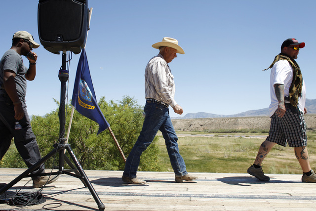 Rancher Cliven Bundy, center, walks on stage to speak at a press conference near Bunkerville, Nev. Thursday, April 24, 2014. (John Locher/Las Vegas Review-Journal)