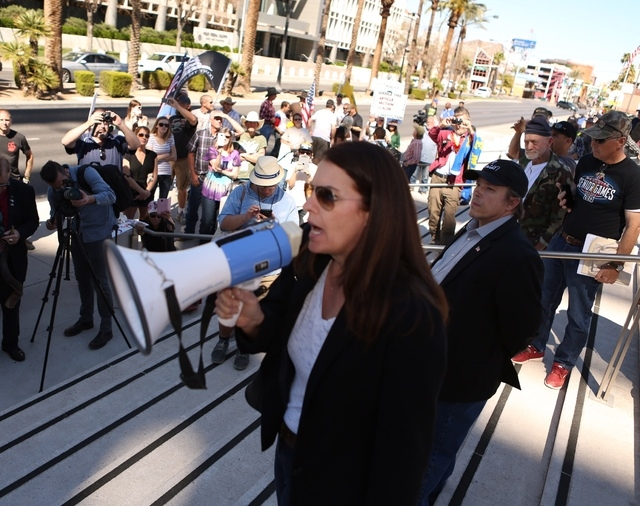 Assemblywoman Shelly Shelton speaks in front of about 100 demonstrators outside the Lloyd George Federal Building on Thursday, March 10, 2016, in Las Vegas. (Jeff Scheid/Las Vegas Review-Journal)
