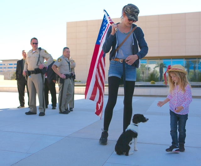 Leslie Enright and her daughter, Maryanne, 4, and dog Mia from California demonstrate in front of the Lloyd George Federal Building on March 10, 2016, in Las Vegas. (Jeff Scheid/Las Vegas Review-J ...