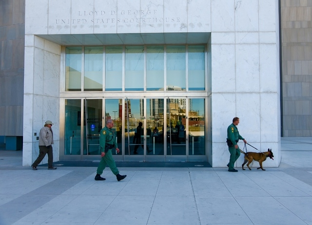 Metro K-9 unit patrols around the Lloyd George Federal Building on Thursday morning, March 10, 2016, in Las Vegas, before demonstrators started gathering. (Jeff Scheid/Las Vegas Review-Journal)