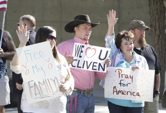 Carol Bundy, wife of Nevada rancher Cliven Bundy, right, her son Arden, center, and her daughter Stetsy Cox, left, protest outside Lloyd George Federal Building on Thursday, March 17, 2016, in Las ...