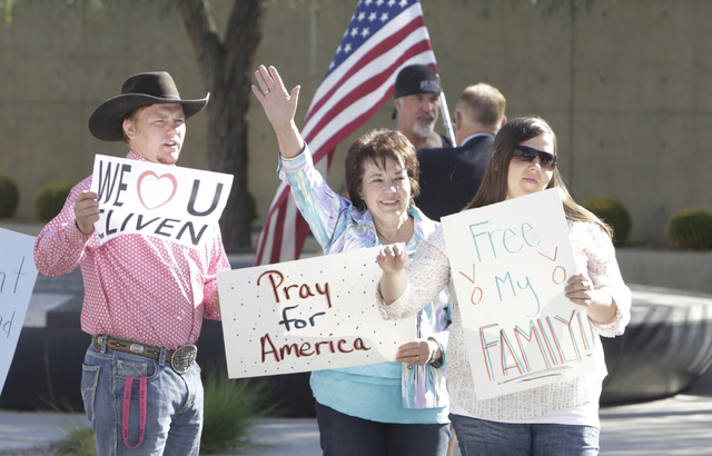Carol Bundy, wife of Nevada rancher Cliven Bundy, center, her son Arden, left, and her daughter Stetsy Cox, protest outside Lloyd George Federal Building on Thursday, March 17, 2016, in Las Vegas. ...