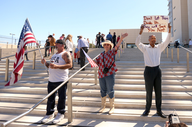 Rick Pollard, left, Cathryn Adams and Calvin Leslie demonstrate in front of Lloyd George Federal Building on March 10, 2016 in Las Vegas. (Jeff Scheid/Las Vegas Review-Journal)