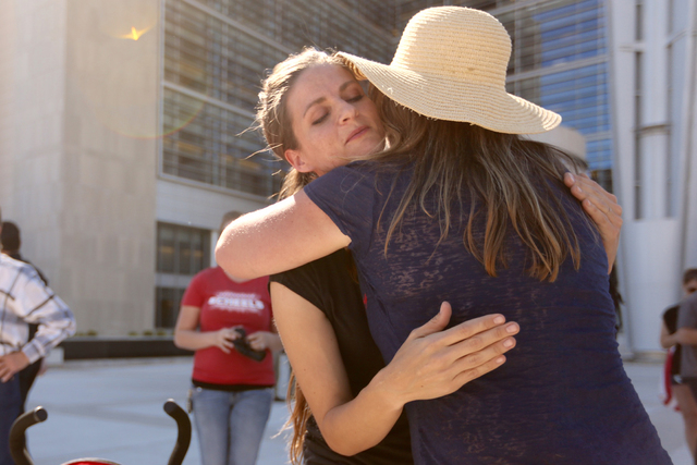 Thara Tenney, left, daughter of Robert La Voy Finicum, gets a hug from Dee (didn't give her last name) in front of the Lloyd George Federal Building on March 10, 2016, in Las Vegas. (Jeff Scheid/L ...