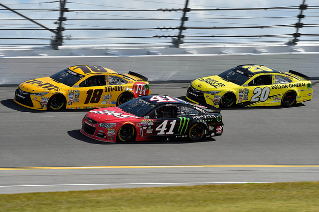 Feb 21, 2016; Daytona Beach, FL, USA; NASCAR Sprint Cup Series driver Kurt Busch (41) and Kyle Busch (18) and in front of Matt Kenseth (20) race during the Daytona 500 at Daytona International Spe ...
