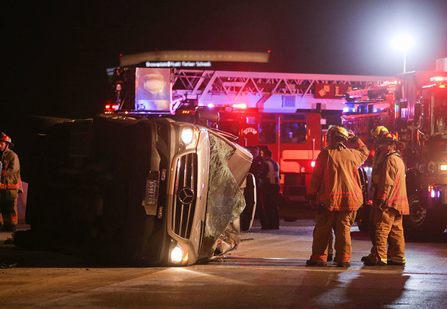 Las Vegas police and fire workers investigate the scene of a crash on northbound I-15 near the Washington Avenue exit on Saturday, March 12, 2016. Brett Le Blanc/Las Vegas Review-Journal Follow @b ...