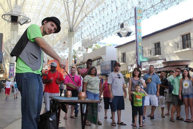 James Kelsey performs magic tricks on Fremont Street on Tuesday, July 28 2015. (James Tensuan/Las Vegas Review-Journal) Follow James Tensuan on Twitter @jtensuan