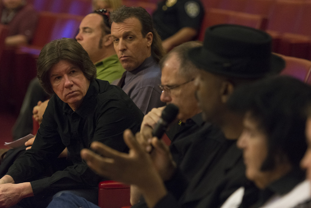 Las Vegas City Attorney Brad Jerbic, left, listens as busker Scarlet Ray Watt, second from right, speaks during a meeting at Las Vegas City Hall Council Chambers Thursday, March 10, 2016. Jason Og ...