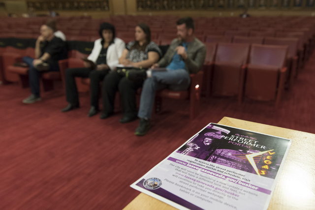 A flyer with information about the city's street performer portal sits on a wall during a meeting to discuss new rules for downtown buskers during a meeting at Las Vegas City Hall Council Chambers ...