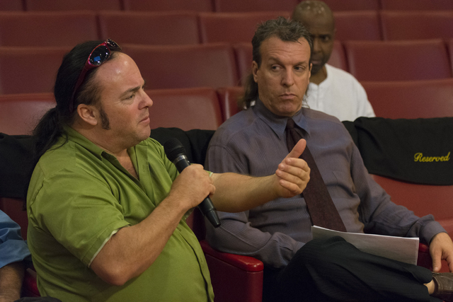 Michael T. Moore, left, speaks with Las Vegas officials about new rules for downtown buskers during a meeting at Las Vegas City Hall Council Chambers Thursday, March 10, 2016. Lucky Joe, center, a ...
