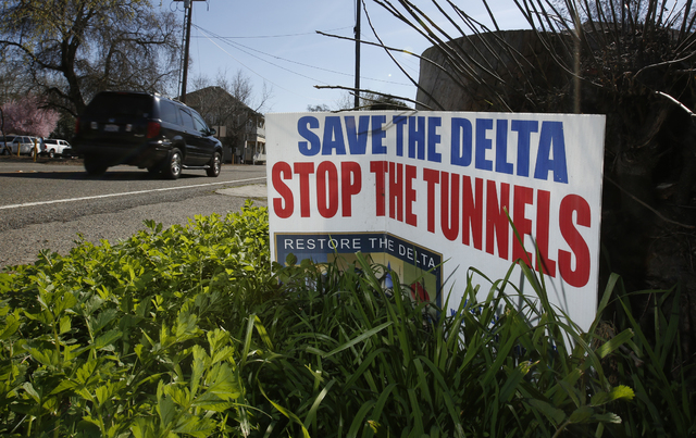 A sign opposing a proposed tunnel plan to ship water through the Sacramento-San Joaquin River Delta to Southern California is displayed near Freeport, Calif., on Feb. 23, 2016. (AP Photo/Rich Pedr ...