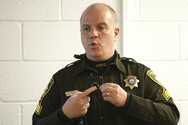 Las Vegas police Sgt. Peter Ferranti demonstrates the department's body cameras during a media presentation at the Mojave Training Center in Las Vegas Wednesday, Nov. 12, 2014. (Erik Verduzco/Las  ...