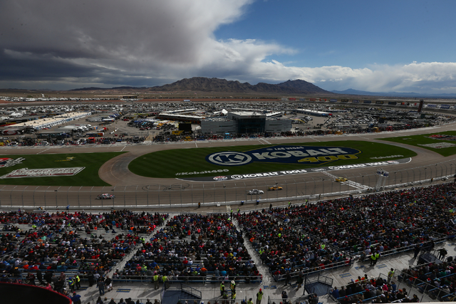 Race cars circle the track at Las Vegas Motor Speedway as the NASCAR Kobalt 400 runs on Sunday, March 6, 2016. Weather delays have slowed the race. Chase Stevens/Las Vegas Review-Journal Follow @C ...