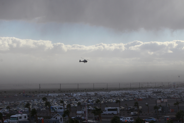 A helicopter flies as a storm approaches Las Vegas Motor Speedway as the NASCAR Kobalt 400 runs on Sunday, March 6, 2016. Weather delays have slowed the race. Chase Stevens/Las Vegas Review-Journa ...