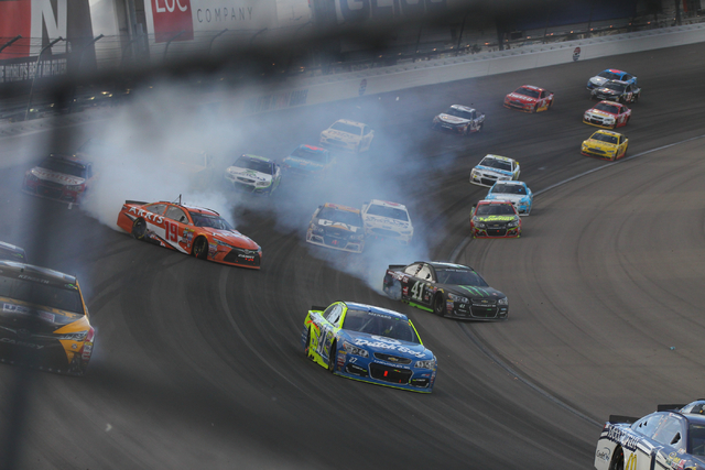 Cars skid on the track as drivers avoid the wall during the NASCAR Kobalt 400 at Las Vegas Motor Speedway on Sunday, March 6, 2016. Weather delays have slowed the race. Chase Stevens/Las Vegas Rev ...