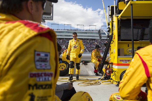 Crew members for Joey Logano (22) wait at their pit stop during the NASCAR Sprint Cup Series Kobalt 400 race at the Las Vegas Motor Speedway in Las Vegas on Sunday, March 6, 2016, in Las Vegas. Er ...