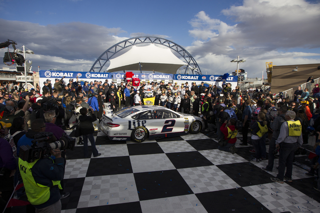 Brad Keselowski and his team celebrate in victory win after win in the NASCAR Sprint Cup Series Kobalt 400 race at the Las Vegas Motor Speedway in Las Vegas on Sunday, March 6, 2016, in Las Vegas. ...