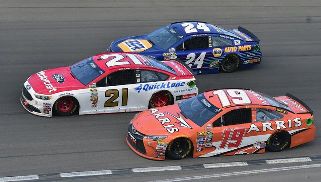 Chase Elliott (24), Ryan Blaney (21), and Carl Edwards (19) go three-wide in turn 4 during the Kobalt 400 at Las Vegas Motor Speedway in Las Vegas Sunday, March. 6, 2016. Josh Holmberg/Las Vegas R ...