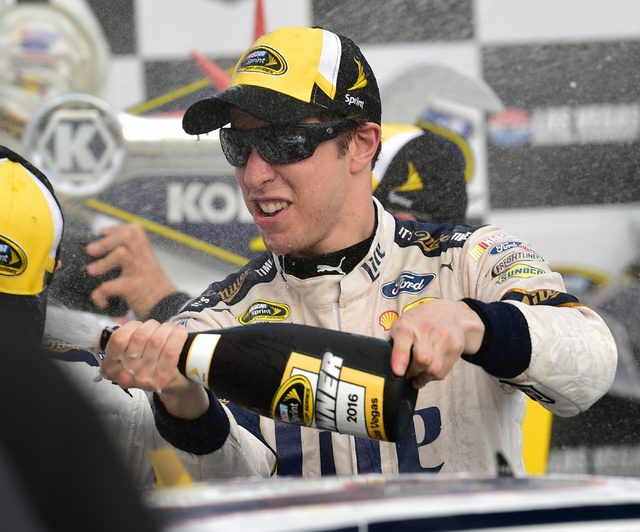 NASCAR Sprint Cup Series driver Brad Keselowski (2) sprays champagne in victory lane after winning the Kobalt 400 at Las Vegas Motor Speedway in Las Vegas Sunday, March. 6, 2016. Josh Holmberg/Las ...