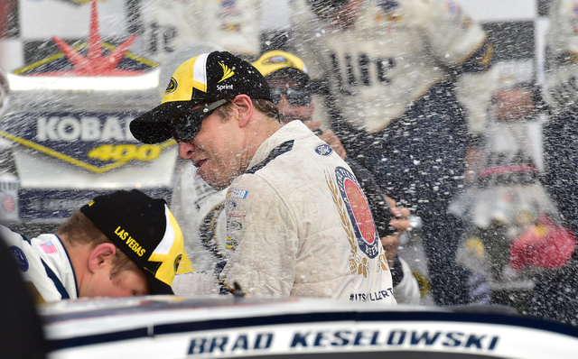 Crew members spray champagne on driver Brad Keselowski (2) in victory lane after their team won  the Kobalt 400 at Las Vegas Motor Speedway in Las Vegas Sunday, March. 6, 2016. Josh Holmberg/Las V ...