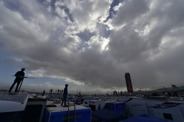 NASCAR fans stand on top of their motorhomes as a storm approaches during the Las Vegas Motor Speedway before the Kobalt 400 race in Las Vegas Sunday, March 6, 2016. Josh Holmberg/Las Vegas Review ...